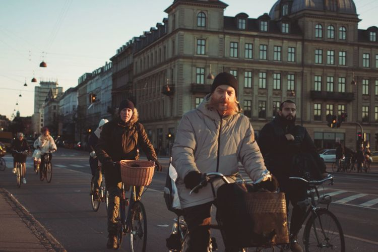 Architecture Bike Built Structure Casual Clothing City City Life City Street Copenhagen Day Hipster Leisure Activity Lifestyles Medium Group Of People Mixed Age Range Outdoors Sky Sunset