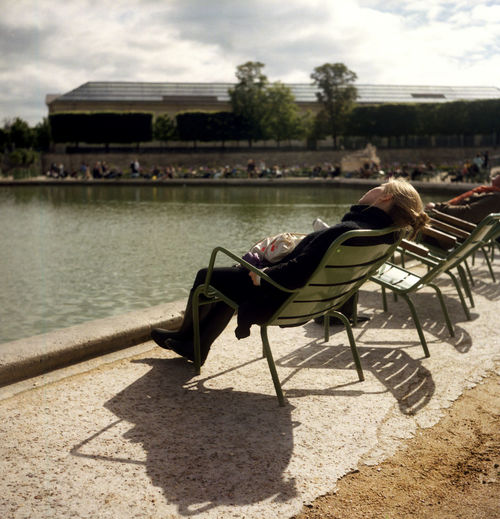 Analogue Photography First Days Of Spring Jardin Des Tuileries Paris Park Life Spring Has Arrived Tree Water Reflections Film Photography Jardin One Person Park Park View Shadow Sunbeams Sunbed Sunny Day EyeEmNewHere Lazy Day Relaxing Young Adult Nice Day Stories From The City