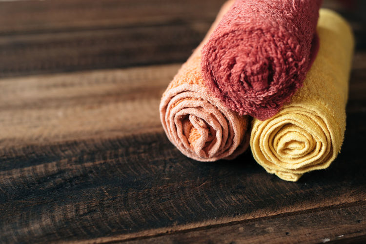 hand towel on wooden table Bath Home Hygiene Absorb Bathroom Brown Close-up Cloth Dry Face Freshness Hand Hotel Material No People Shower Simplicity Softness Spa Still Life Table Textile Towel Wood - Material Wool