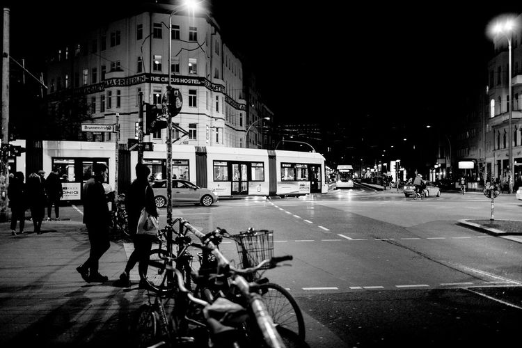 View of bicycles parked in city at night