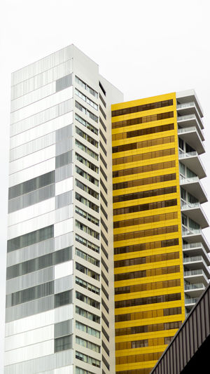 Building Exterior Architecture Built Structure Building City Office Building Exterior Low Angle View Modern No People Office Sky Tall - High Skyscraper Clear Sky Day Nature Outdoors Window Yellow Pattern Apartment Architecture Architecture_collection Australia Beauty In Nature