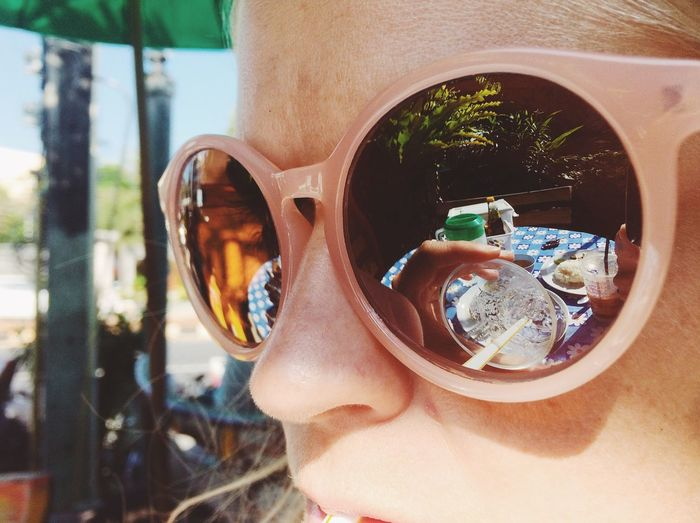 Close-Up Of Woman With Reflection On Sunglasses