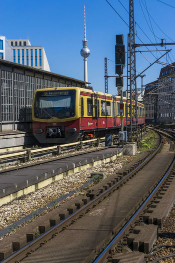 S-Bahn train leaving Friedrichstrasse Station with TV Tower in background Berlin Friedrichstrasse Station Germany 🇩🇪 Deutschland Architecture Built Structure Cable Clear Sky Color Image Day Electricity Pylon Mode Of Transport No People Outdoors Public Transportation Rail Transportation Railroad Track Sky Sunlight Train - Vehicle Transportation Vertical