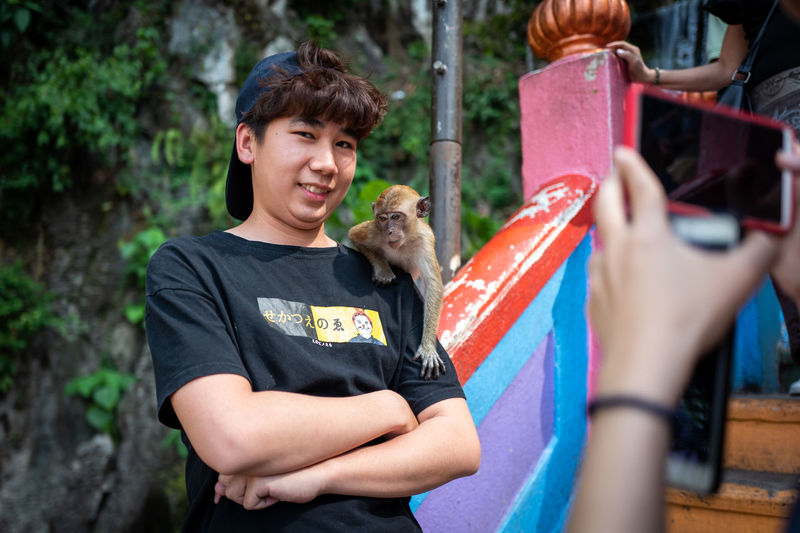 Kuala Lumpur Smiling Portrait Holding Waist Up Men Casual Clothing Happiness Emotion Boys One Animal Males  Young Adult Day People Child Real People Looking At Camera Mammal Teenager Outdoors Adolescence  Teenage Boys Batucaves