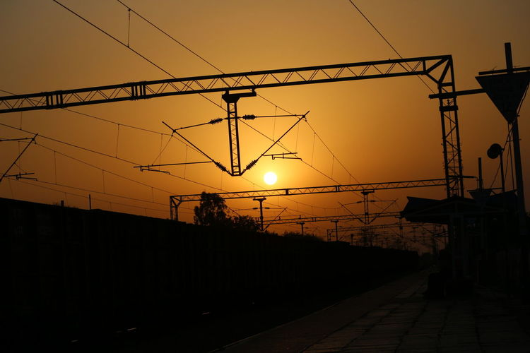 Sunset Silhouette Sun Business Finance And Industry Fuel And Power Generation Cable Dusk Electricity  Electricity Pylon No People Sky Outdoors Hanging Industry Clear Sky Overhead Cable Car City Nature Day Train Station Taking Photos DSLR Photography EyeEm Eyeem India Man Made Object