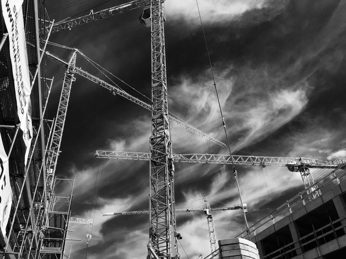 Development Low Angle View Construction Site Crane - Construction Machinery Sky Cloud Construction Cloud - Sky Progress Tall Outdoors Construction Machinery Improvement Day Dramatic Sky Tall - High Cloudy Storm Cloud No People High Section