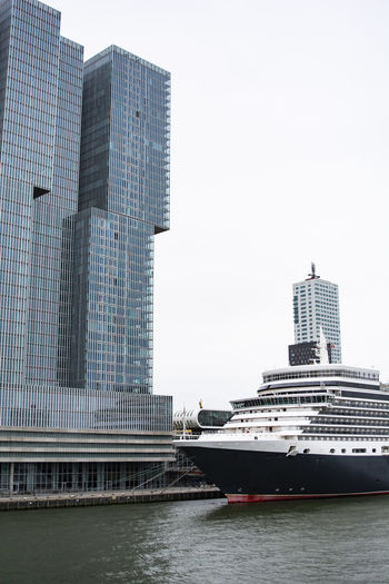 Architecture Building Building Exterior Built Structure City Cityscape Clear Sky Cruise Ship Day Financial District  Luxury Modern Nature Nautical Vessel No People Office Office Building Exterior Outdoors Sky Skyscraper Tall - High Tower Water Waterfront