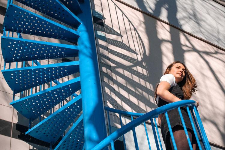 Portrait of woman on railing