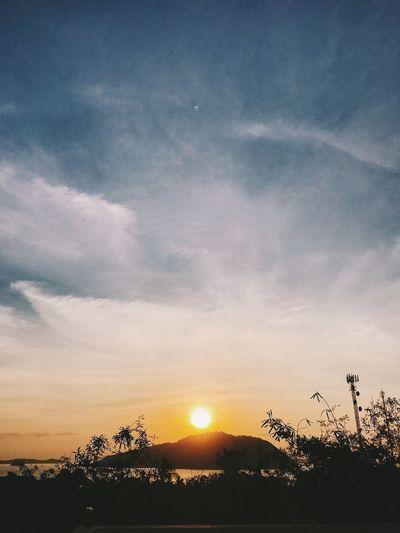 Sky Sunset Cloud - Sky Beauty In Nature Tree Tranquility Scenics - Nature Tranquil Scene Sun Plant Silhouette Nature No People Sunlight Orange Color Landscape Idyllic Sunbeam Non-urban Scene Environment Outdoors Lens Flare Bright