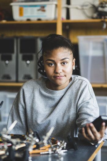Portrait of teenage boy sitting on table