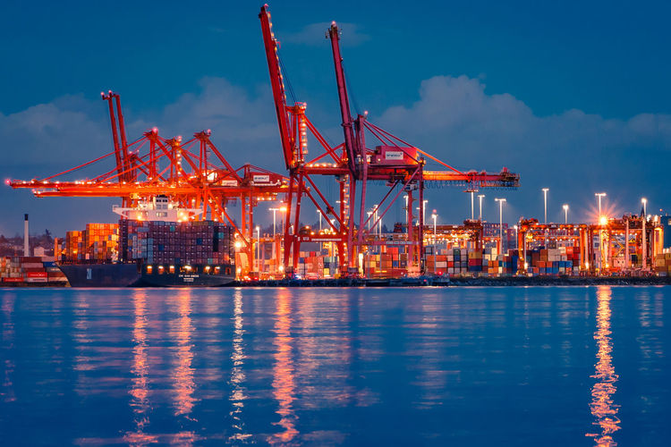 Water Industry Waterfront Illuminated Freight Transportation Business Commercial Dock Shipping  Crane - Construction Machinery Pier Machinery Transportation Harbor Night Architecture Sky Container Nature Sea No People Outdoors Industrial Equipment