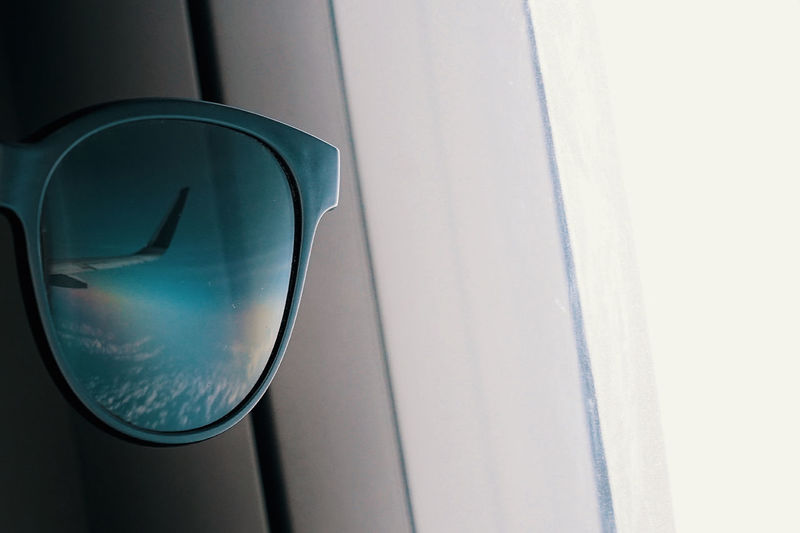 Close-up of sunglasses on car window