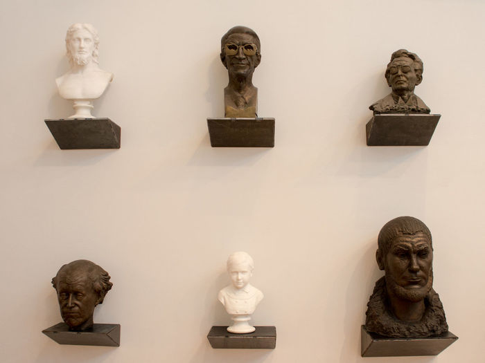Heads on the wall Bust  Human Representation Indoors  Male Likeness Museum No People Sculpture Statue White Background
