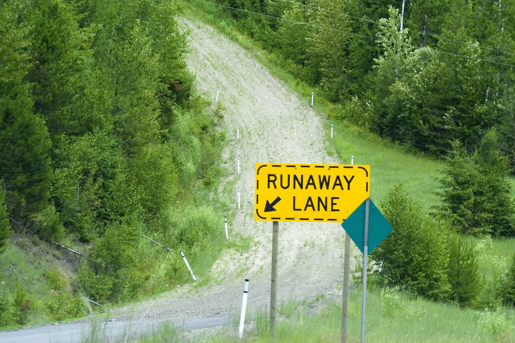 runaway lane uphill - safety in the mountains for trucks with hot brakes Brake Communication Danger Emergency Emergency Exit Freight Transportation Gravel Road Guidance Hot Brakes Lane Mountain Road Road Sign Runaway Runaway Lane Safety Safety First! Sign Steep Text Traffic Transportation Truck Trucks Uphill