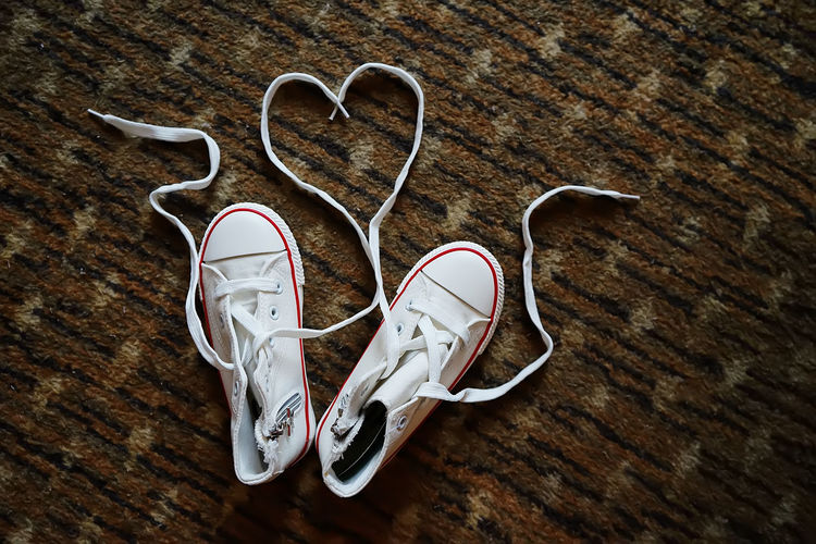Love Concept Shoe Still Life Pair No People Indoors  Close-up High Angle View Two Objects Personal Accessory Flooring White Color Hardwood Floor Wood Wood - Material Love Love ♥ Conceptual Conceptual Photography