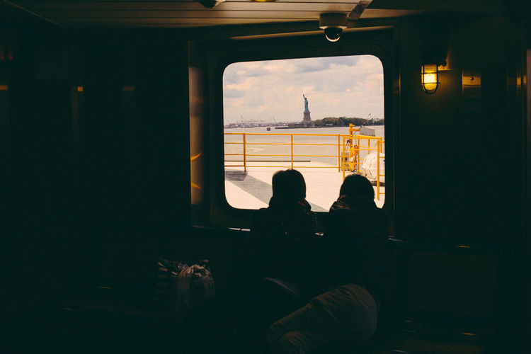 Staten Island Staten Island Ferry Statue Of Liberty Adult Architecture Glass - Material Indoors  Leisure Activity Lifestyles Men Mode Of Transportation Nature People Real People Sitting Transparent Transportation Vehicle Interior Window Women