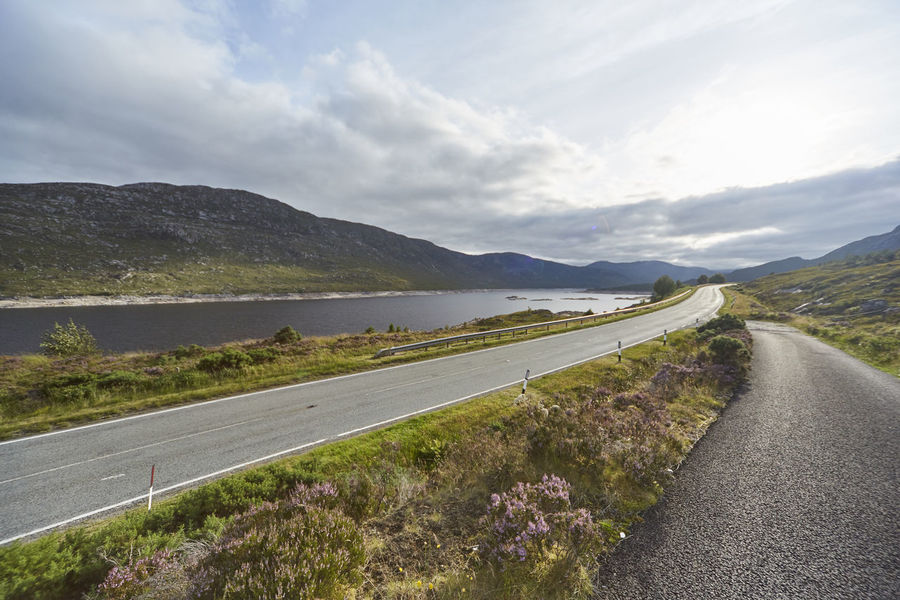 Road Transportation Mountain Sky Cloud - Sky Water Beauty In Nature Scenics - Nature Nature Tranquil Scene Tranquility Plant Direction The Way Forward No People Day Mountain Range Landscape Environment Outdoors Highlands Scotland Scottish Details Nature Wonderful Colors Orkneys