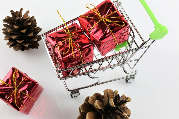 An concept Image of a Shopping cart with a gift - christmas Chritmas Shopping Trolley Trolly Xmas Xmas Decorations Basket Birthday Buying Cart Concept Costomer Decoration Gift Gifts