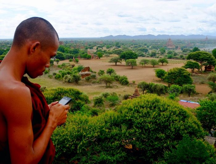 Tech bug got the monk Tree One Person Landscape Field Outdoors Lifestyles Nature Growth Sky Real People Young Adult Day Drone  People Monk Robe Monk And Tech Monk On Cellular Myanmar Mobile Conversations