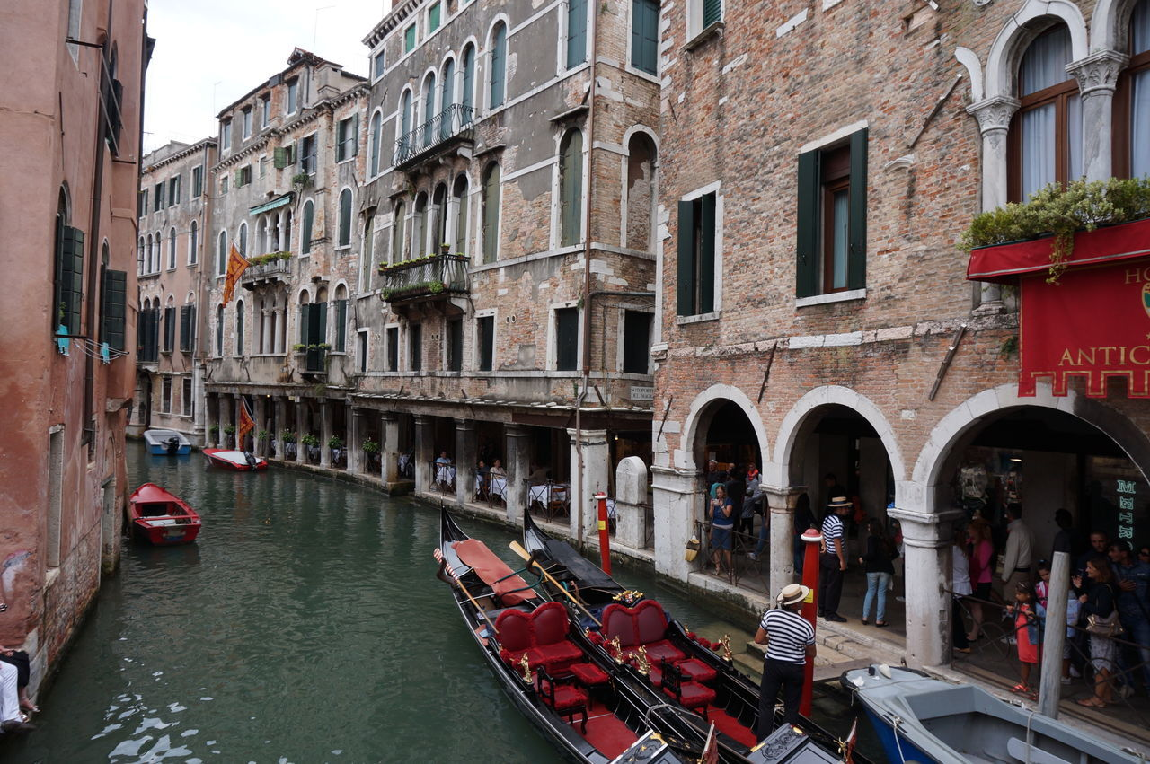 Boats In Canal Amidst Buildings In City