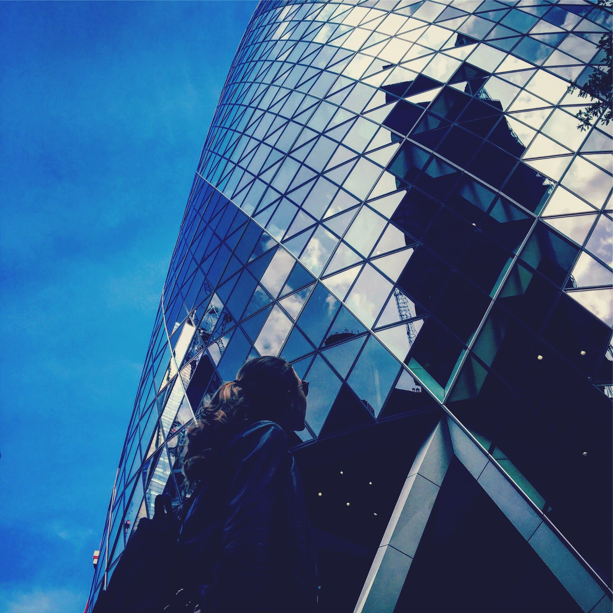 architecture, low angle view, built structure, modern, building exterior, skyscraper, reflection, real people, sky, city, travel destinations, day, blue, outdoors