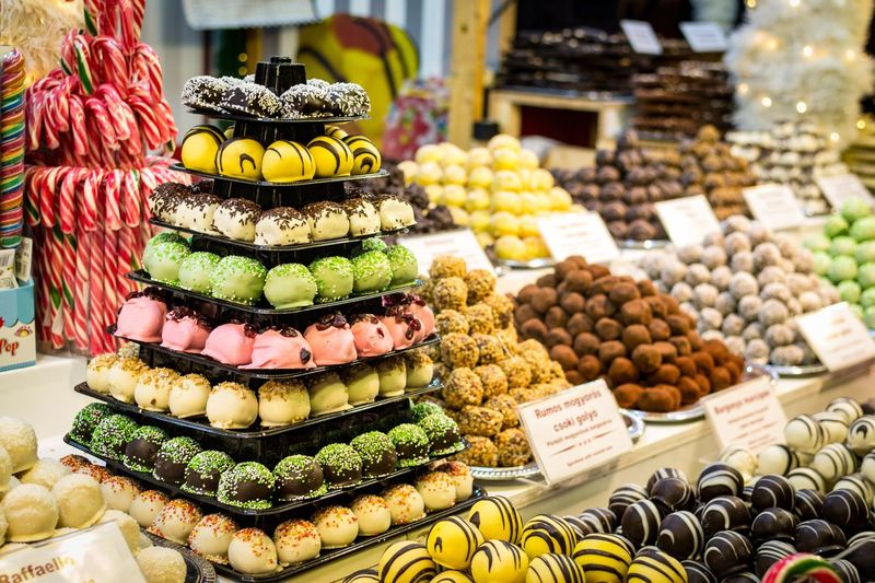 Various sweet food for sale at market stall