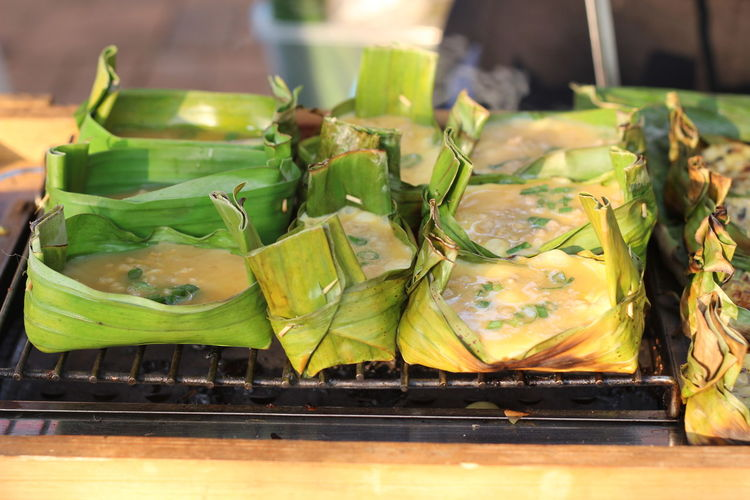 Close-up of green leaves on table at market stall