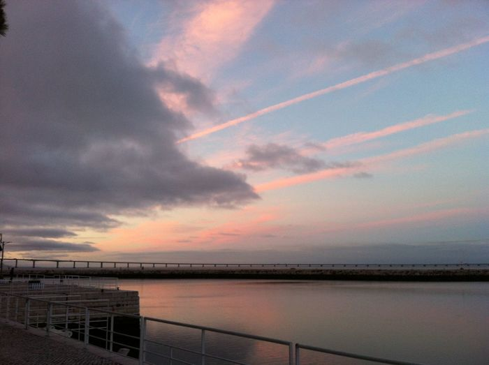 Pink sunset in blue sky reflected accros sea Horizon Over Water Nature Pink And Blue Sunset Reflection In Sea Scenics Sea Sky Sunset Tranquil Scene Water