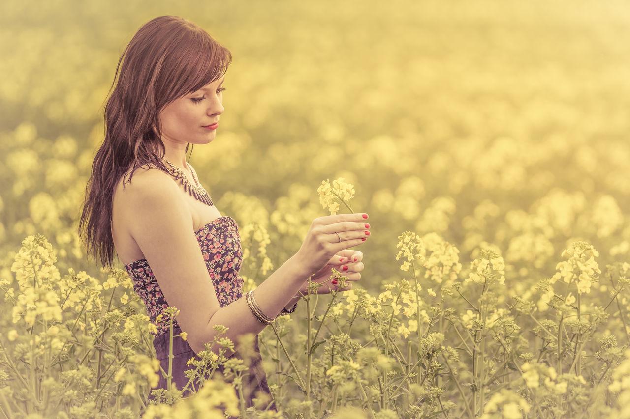 Beautiful Woman Standing On Flowering Field