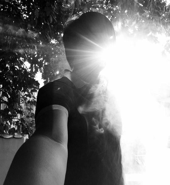 Lens Flare Sunlight Mid Adult Adults Only One Person Women Adult Outdoors Tree People Men Lifestyles Nature Sunbeam One Woman Only Day Real People Beauty Sun Only Women Silhouette