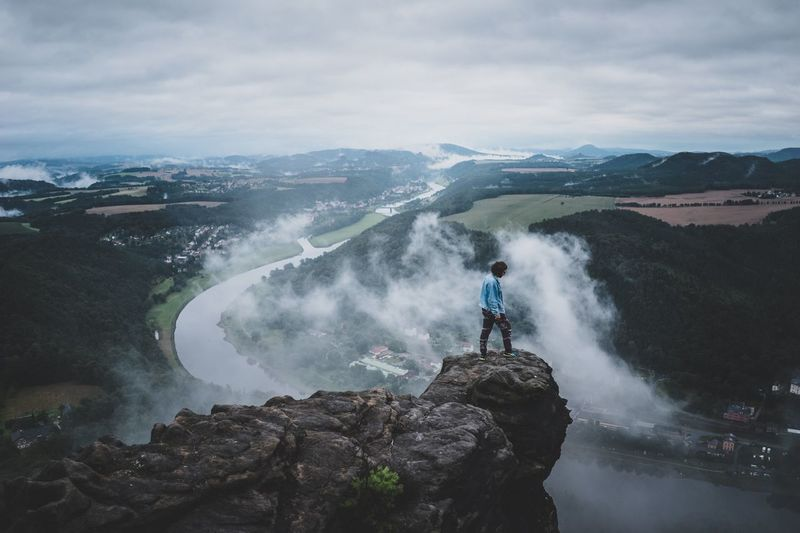 Outdoor shot of guy standing over Elbe river Morning Fog Live Authentic Nature Adventure Roam Lilienstein Saxon Switzerland Elbe River Real People Motion One Person Leisure Activity Beauty In Nature Mountain Nature Sky Rock - Object Water Waterfall Adventure Scenics Outdoors Full Length Lifestyles Long Exposure Cloud - Sky Standing Day The Great Outdoors - 2018 EyeEm Awards The Great Outdoors - 2018 EyeEm Awards
