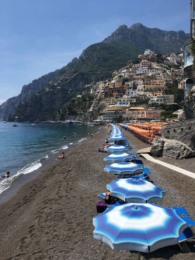 Beach & Italy food. Architecture Beach Beauty In Nature Blue Building Exterior Built Structure Day Mountain Nature No People Outdoors Popckorn Positano Sand Scenics Sea Sky Umbrella Water