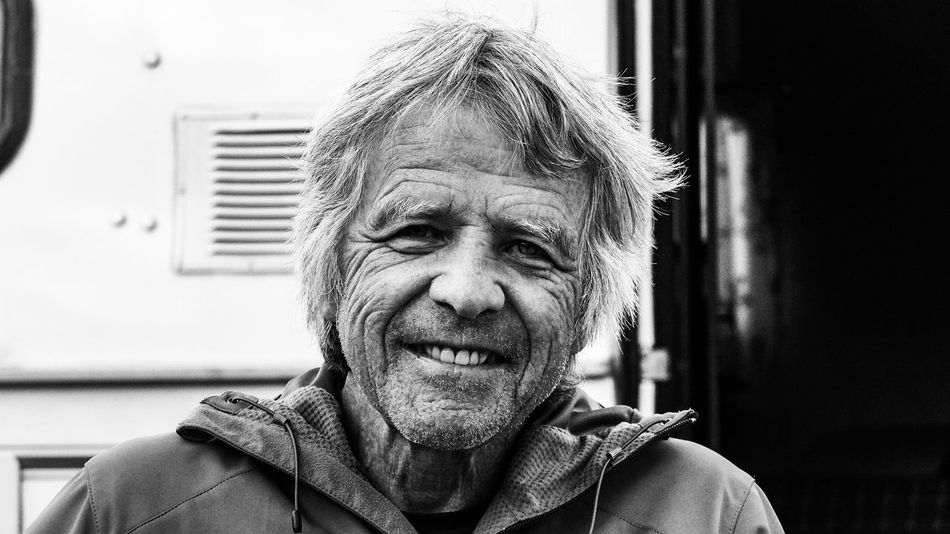 Senior Adult Headshot One Person Portrait Bw Looking At Camera Wrinkle Of Life Wrinkles On The Face Cycletouring Outdoors Canada Coast To Coast Solotraveler Prarie Cycling Trip