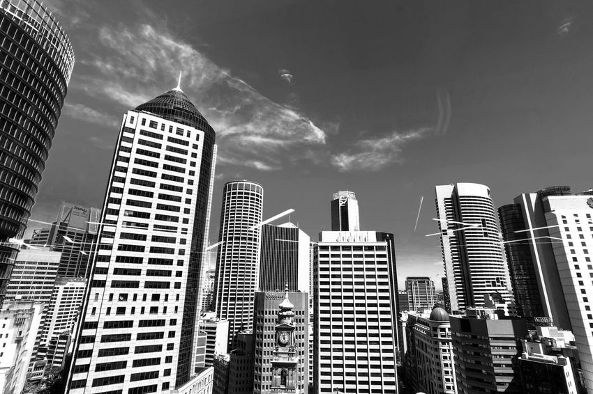 Sunny day Light And Shadow Monochrome Black And White Blackandwhite Skyscraper Building Exterior Architecture Modern City Built Structure Tower Cityscape Sky Low Angle View Travel Destinations Outdoors Day Downtown District Cloud - Sky Urban Skyline