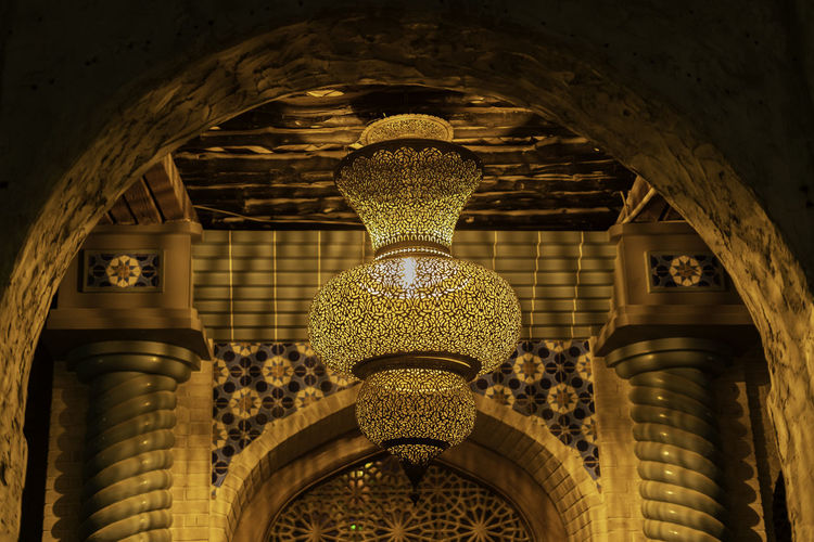 Luxury Glass Arabic Traditional Lamp in Warm Yellow Light Arabic Architecture Arch Indoors  No People Low Angle View Built Structure Building Lighting Equipment Ceiling Pattern Day Illuminated Architectural Column History Hanging The Past Design Electric Lamp Close-up Ornate Luxury Ijas Muhammed Photography Light Lamp Qatar Saudi Arabia Traditional