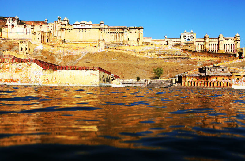 Amer Fort By River Against Clear Sky