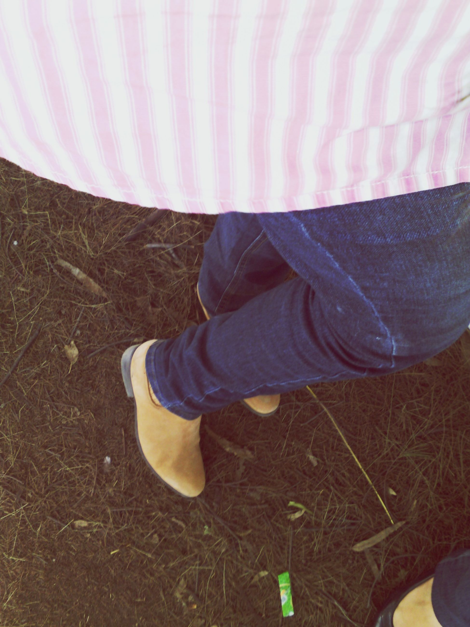 low section, lifestyles, person, leisure activity, shoe, casual clothing, standing, jeans, field, men, grass, high angle view, personal perspective, relaxation, day, footwear