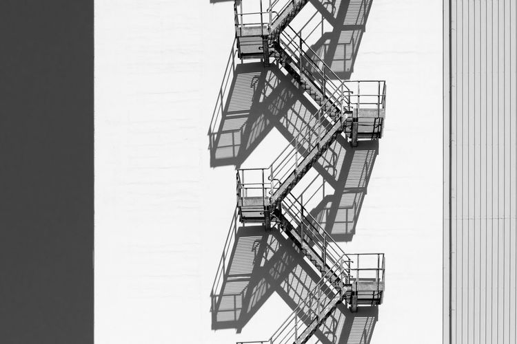 Architecture Accidents And Disasters Apartment Architecture Building Building Exterior Built Structure Day Emergency Exit Fire Escape Hoffi99 Low Angle View Nature No People Outdoors Protection Railing Safety Security Spiral Staircase Steps And Staircases Wall