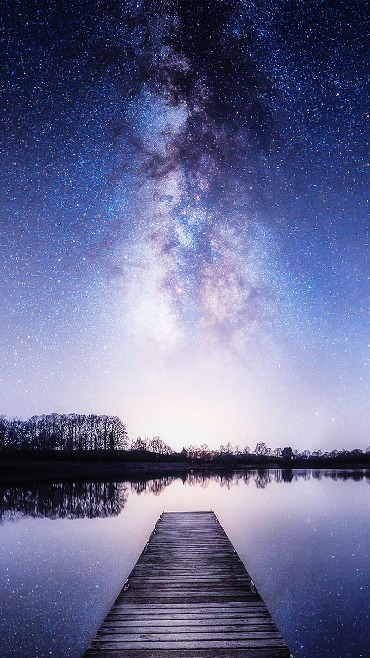 star - space, infinity, water, tranquil scene, scenics, lake, pier, night, sky, beauty in nature, nature, tranquility, outdoors, the way forward, no people, astronomy, galaxy, starry, constellation, milky way