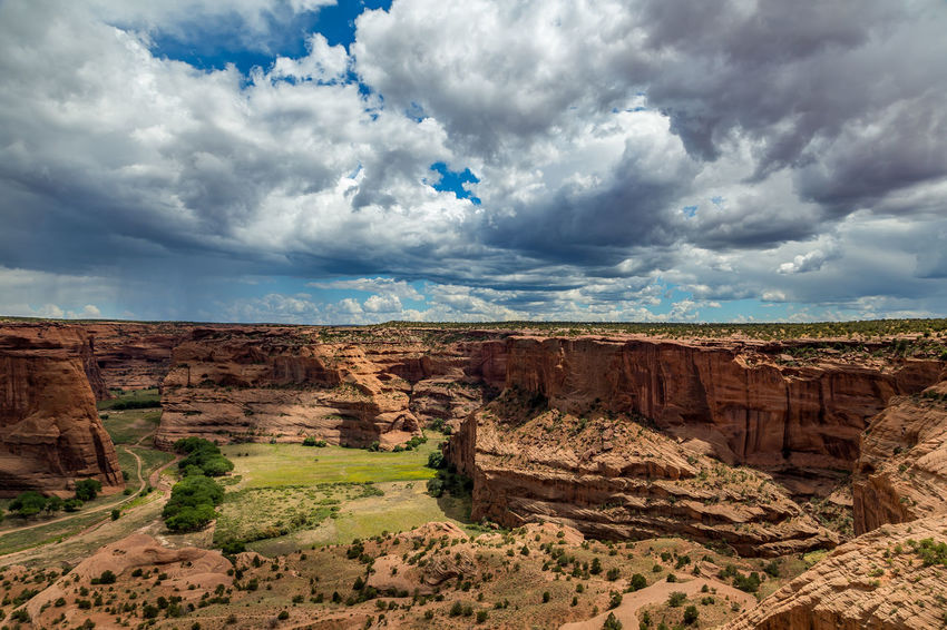 The Canyon de Chelly National Monument consists of many well-preserved Anasazi ruins and spectacular sheer red cliffs that rise up to 1000 feet. Arizona Canyon Canyon De Chelly National Monument Cloud - Sky Day Geology Landscape Nature No People Outdoors Ravine Rock - Object