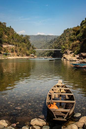 Fishing boat at river shore at morning from flat angle