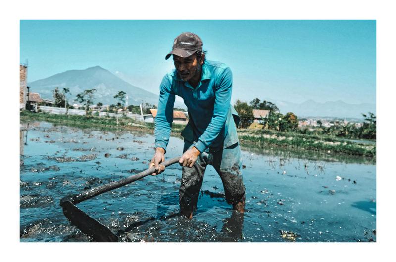 Manual worker working at mud