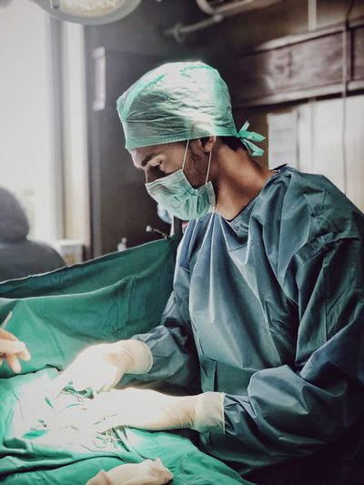 Surgeon picking tools at operating room
