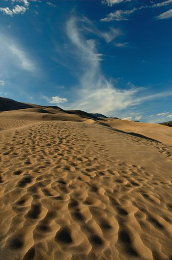 Great Sand Duners, Colorado Arid Climate Beach Beauty In Nature Blue Cloud Cloud - Sky Day Desert Natural Pattern Nature No People Non-urban Scene Outdoors Remote Sand Sand Dune Sandy Scenics Shore Sky Surface Level Tranquil Scene Tranquility Wave Pattern