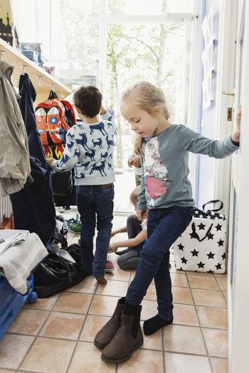 Children playing on tiled floor