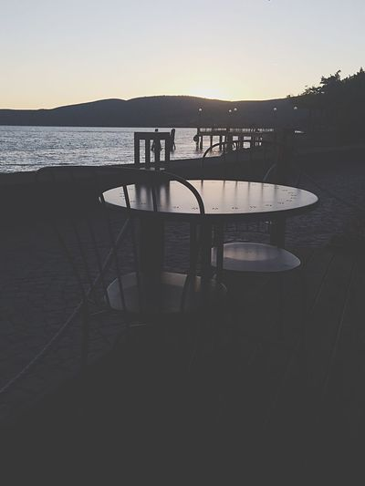 Sky Sunset Trevignanoromano Italy Chair Table Outdoor Cafe Empty Silhouette Water Nature Sea Outdoors No People Tranquil Scene Beauty In Nature Relaxation Clear Sky Day Panorama Taking Photos Popular Photos EyeEm Best Shots EyeEm Nature Lover EyeEm Gallery