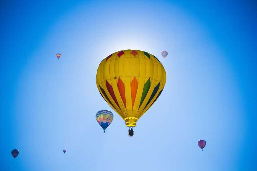 Globo Aerostático Air Vehicle Hot Air Balloon Balloon Sky Flying Transportation Mid-air Blue Adventure Multi Colored Nature Freedom Clear Sky Ballooning Festival Low Angle View Mode Of Transportation Travel Fun Day Sport