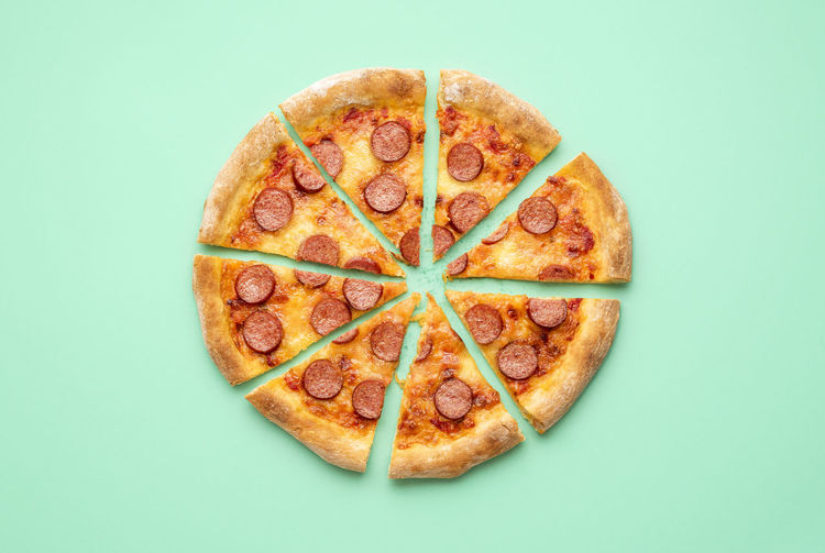 High angle view of pizza against white background