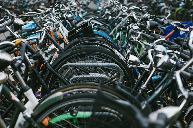 Bicycles parked on road in city