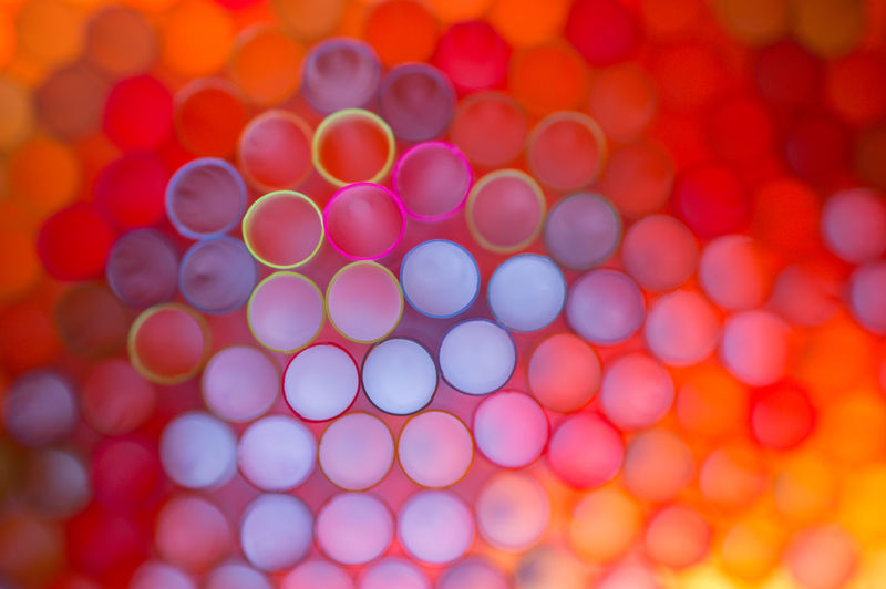 The tube series, pt. 9 - Neon is the word (Macro shot of backlit drinking straws) Plastic Abstract Backgrounds Backlight Circles Close-up Cluster Color Palette Drinking Straws Fine Art Geometric Shapes Glowing In A Row Large Group Of Objects Maximum Closeness Macro Multi Colored Neon Orange Pattern Beautifully Organized Repetition Shapes Side By Side Tubes Neon Life Market Bestsellers 2017